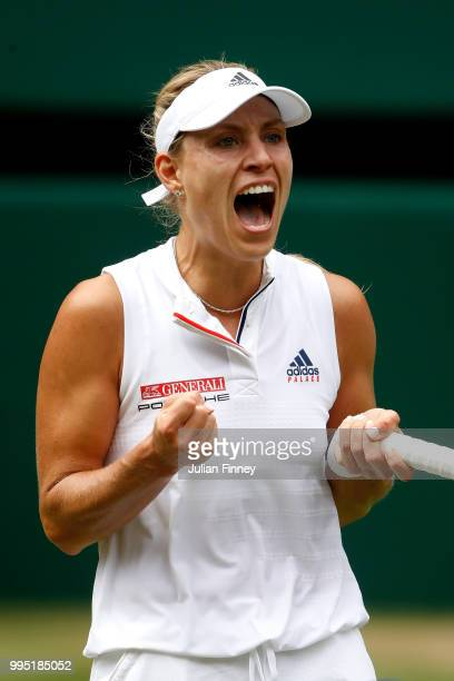 Angelique Kerber of Germany celebrates after defeating Daria Kasatkina of Russia during their Ladies' Singles QuarterFinals match on day eight of the...