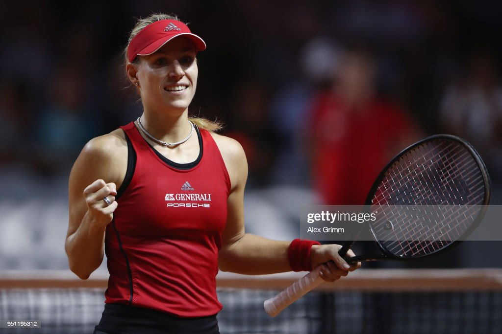 Angelique Kerber of Germany celebrates after defeating Petra Kvitova of Czech Republic during day 3 of the Porsche Tennis Grand Prix at Porsche-Arena on April 25, 2018 in Stuttgart, Germany.