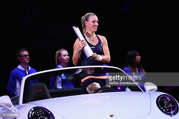 Angelique Kerber of Germany celebrates after her victory in her final match against Caroline Wozniacki of Denmark during Day 7 of the Porsche Tennis...