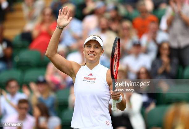 Angelique Kerber of Germany celebrates after victory in her Ladies' Singles third Round match against Aliaksandra Sasnovich of Belarus during Day Six...