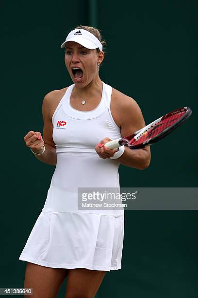 Angelique Kerber of Germany celebrates after winning her Ladies' Singles third round match against Kirsten Flipkens of Belgium on day six of the...