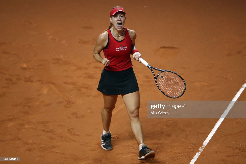Angelique Kerber of Germany celebrates during her match against Petra Kvitova of Czech Republic during day 3 of the Porsche Tennis Grand Prix at Porsche-Arena on April 25, 2018 in Stuttgart, Germany.