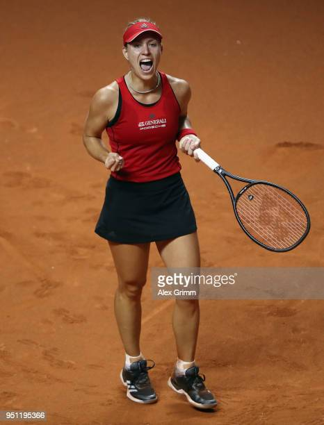 Angelique Kerber of Germany celebrates during her match against Petra Kvitova of Czech Republic during day 3 of the Porsche Tennis Grand Prix at...