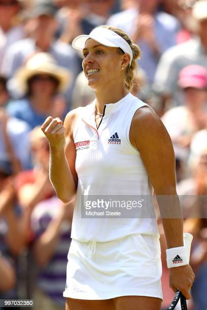 Angelique Kerber of Germany celebrates match point against Jelena Ostapenko of Latvia during their Ladies' Singles semifinal match on day ten of the...