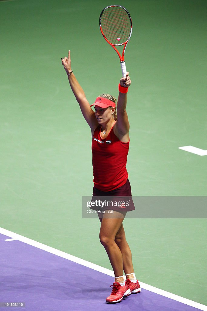 Angelique Kerber of Germany celebrates match point against Petra Kvitova of Czech Republic in a round robin match during the BNP Paribas WTA Finals at Singapore Sports Hub on October 26, 2015 in Singapore.