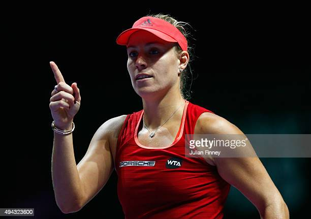 Angelique Kerber of Germany celebrates match point against Petra Kvitova of Czech Republic in a round robin match during the BNP Paribas WTA Finals...