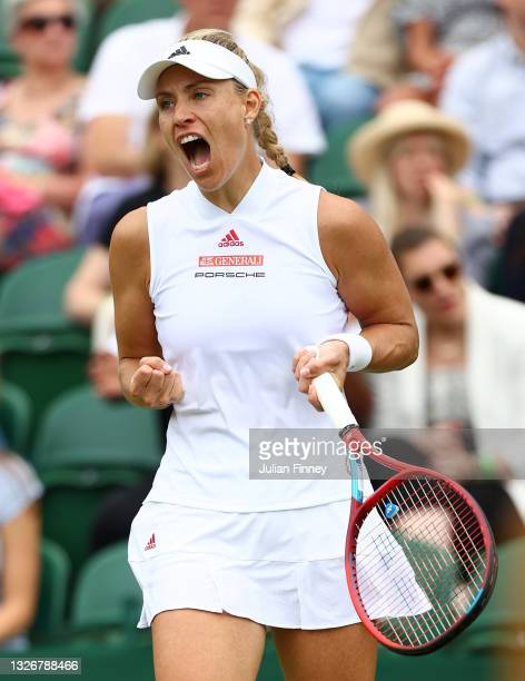 Angelique Kerber of Germany celebrates match point during her Ladies' Singles third Round match against Aliaksandra Sasnovich of Belarus during Day...