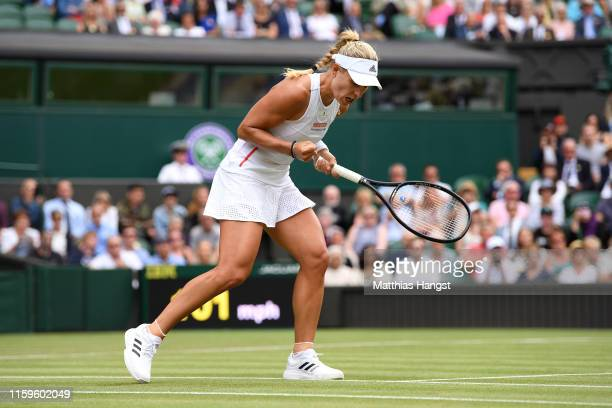 Angelique Kerber of Germany celebrates match point in her Ladies' Singles first round match against Tatjana Maria of Germany during Day two of The...