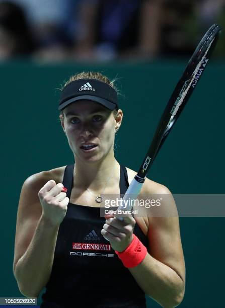 Angelique Kerber of Germany celebrates match point in her women's singles match against Naomi Osaka of Japan during day 4 of the BNP Paribas WTA...