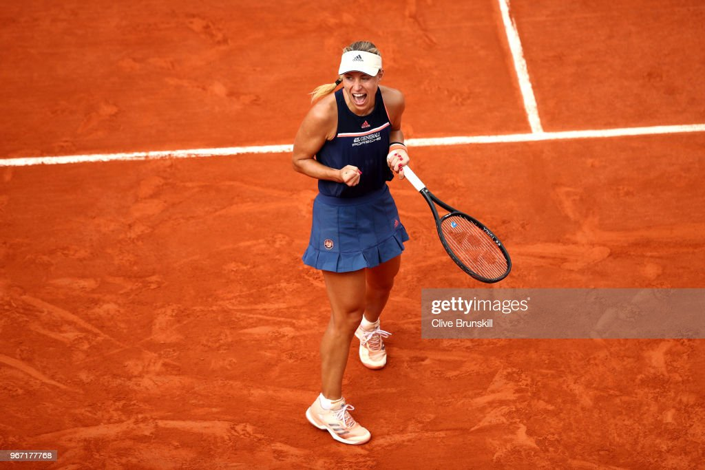 Angelique Kerber of Germany celebrates victory during her ladies singles fourth round match against Caroline Garcia of France during day nine of the 2018 French Open at Roland Garros on June 4, 2018 in Paris, France.