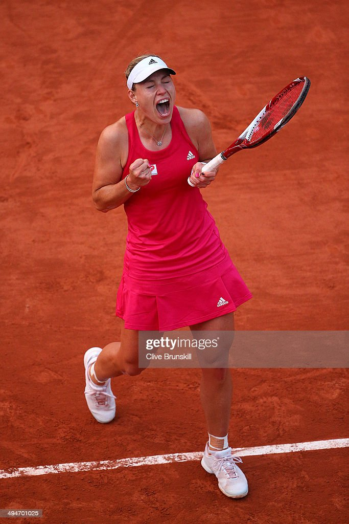 Angelique Kerber of Germany celebrates victory during her women's singles match against Daniela Hantuchova of Slovakia on day six of the French Open at Roland Garros on May 30, 2014 in Paris, France.