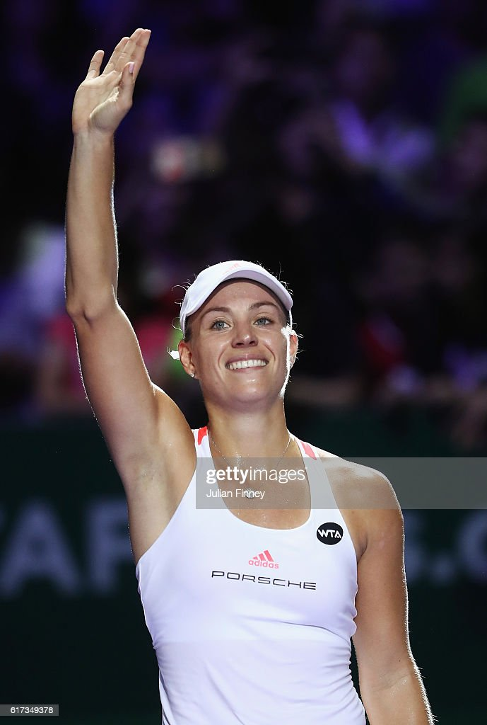 Angelique Kerber of Germany celebrates victory in her singles match against Dominika Cibulkova of Slovakia during day 1 of the BNP Paribas WTA Finals Singapore at Singapore Sports Hub on October 23, 2016 in Singapore.