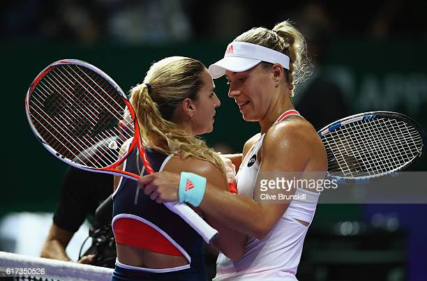 Angelique Kerber of Germany celebrates victory in her singles match against Dominika Cibulkova of Slovakia during day 1 of the BNP Paribas WTA Finals...