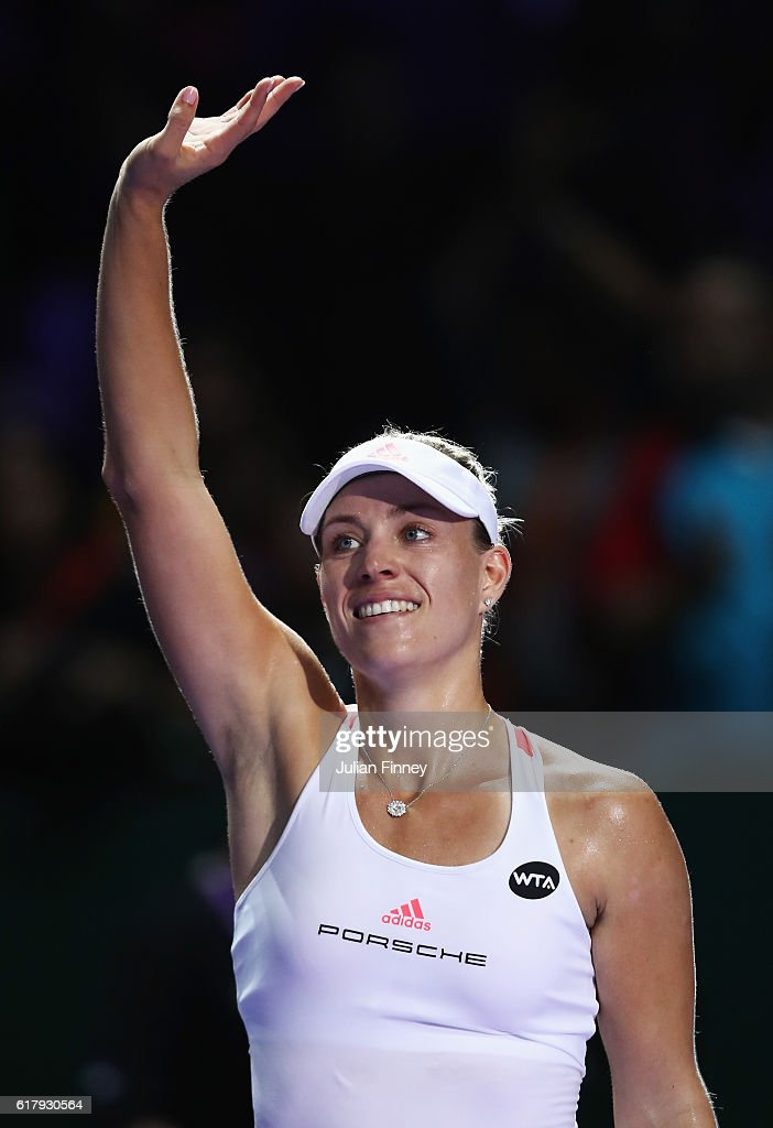 Angelique Kerber of Germany celebrates victory in her singles match against Simona Halep of Romania during day 3 of the BNP Paribas WTA Finals Singapore at Singapore Sports Hub on October 25, 2016 in Singapore.