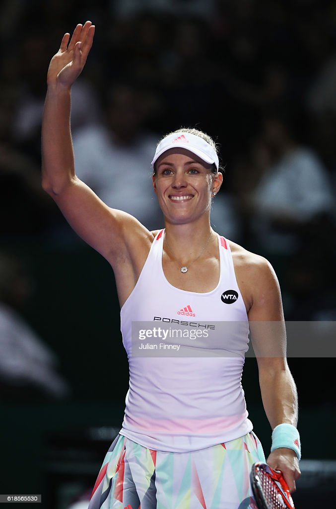 Angelique Kerber of Germany celebrates victory in her singles match against Madison Keys of the United States during day 5 of the BNP Paribas WTA Finals Singapore at Singapore Sports Hub on October 27, 2016 in Singapore.
