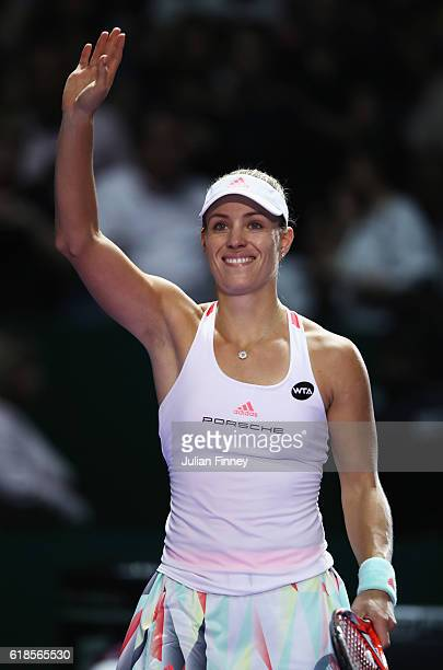 Angelique Kerber of Germany celebrates victory in her singles match against Madison Keys of the United States during day 5 of the BNP Paribas WTA...