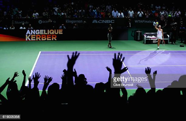 Angelique Kerber of Germany celebrates victory in her singles semifinal match against Agnieszka Radwanska of Poland during day 7 of the BNP Paribas...