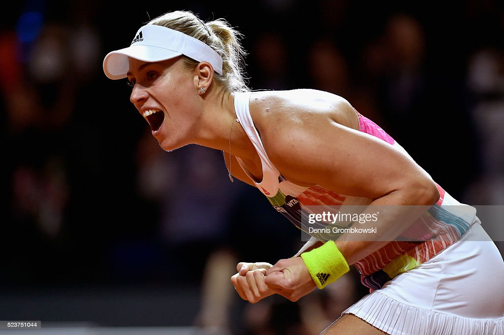 Angelique Kerber of Germany celebrates victory in the singles final match against Laura Siegemund of Germany on Day 7 of the Porsche Tennis Grand Prix at Porsche-Arena on April 24, 2016 in Stuttgart, Germany.
