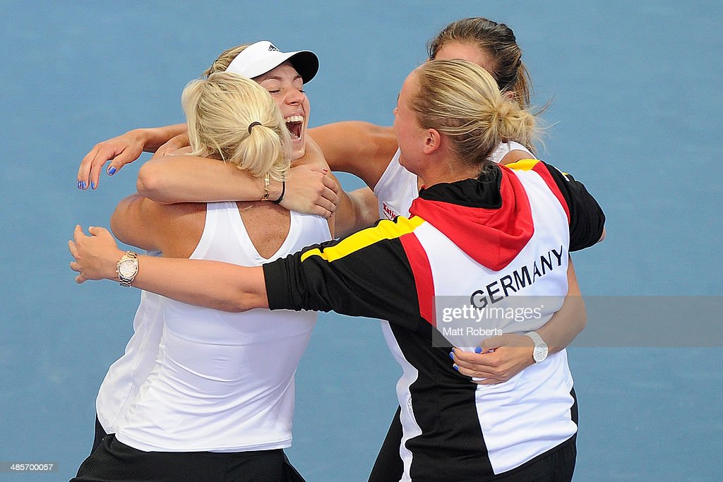 Angelique Kerber of Germany celebrates victory with team-mates after her match against Samantha Stosur of Australia during the Fed Cup Semi Final tie between Australia and Germany at Pat Rafter Arena on April 20, 2014 in Brisbane, Australia.