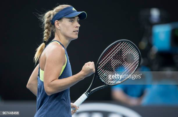Angelique Kerber of Germany celebrates winning a point in her third round match against Maria Sharapova of Russia on day six of the 2018 Australian...