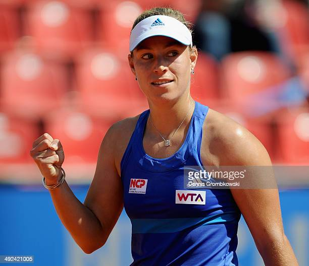 Angelique Kerber of Germany celebrates winning her match against Marina Erakovic of New Zealand during Day 4 of the Nuernberger Versicherungscup on...