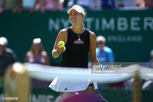 Angelique Kerber of Germany celebrates winning her women's singles quarter-final match against Simona Halep of Romania during day four of the Nature...