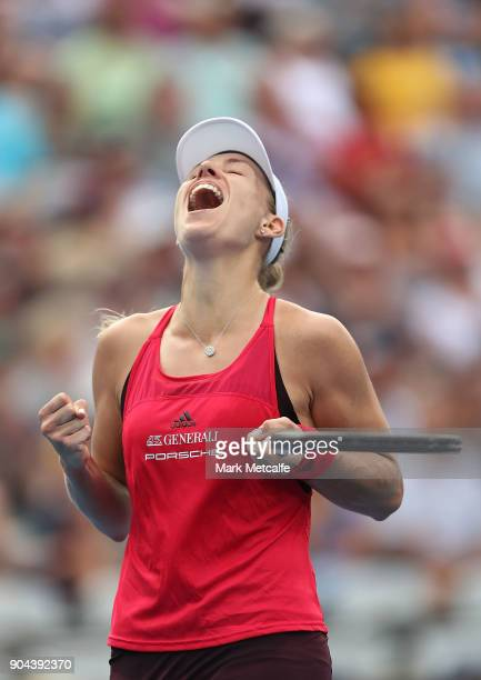 Angelique Kerber of Germany celebrates winning match point in her Women's Singles Final match against Ashleigh Barty of Australia during day seven of...