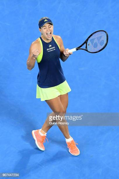 Angelique Kerber of Germany celebrates winning match point in her third round match against Maria Sharapova of Russia on day six of the 2018...