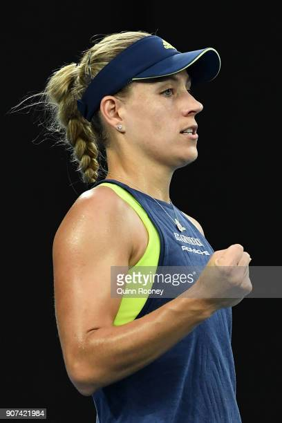 Angelique Kerber of Germany celebrates winning the first set in her third round match against Maria Sharapova of Russia on day six of the 2018...