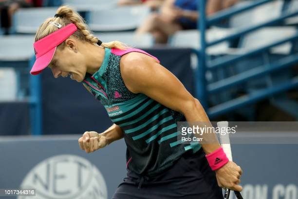 Angelique Kerber of Germany celebrates winning the second set against Anastasia Pavlyuchenkova of Russia during Day 5 of the Western and Southern...