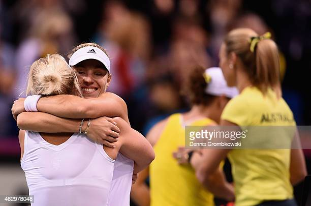 Angelique Kerber of Germany celebrates with team captain Barbara Rittner after her single match against Samantha Stosur of Australia during the Fed...