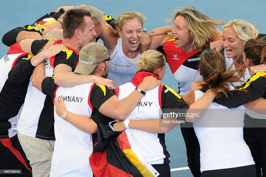 Angelique Kerber of Germany celebrates with team-mates after her match against Samantha Stosur of Australia during the Fed Cup Semi Final tie between Australia and Germany at Pat Rafter Arena on April 20, 2014 in Brisbane, Australia.