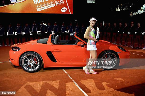 Angelique Kerber of Germany celebrates with the trophy after the singles final match against Laura Siegemund of Germany on Day 7 of the Porsche...