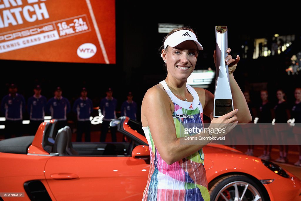 Angelique Kerber of Germany celebrates with the trophy after the singles final match against Laura Siegemund of Germany on Day 7 of the Porsche Tennis Grand Prix at Porsche-Arena on April 24, 2016 in Stuttgart, Germany.