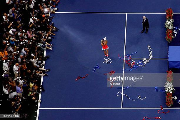 Angelique Kerber of Germany celebrates with the trophy after winning against Karolina Pliskova of the Czech Republic during their Women's Singles...