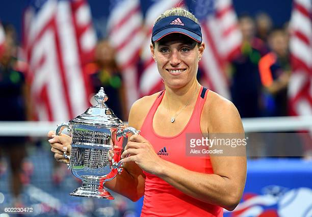 Angelique Kerber of Germany celebrates with the trophy after winning , , against Karolina Pliskova of the Czech Republic during their Women's Singles...