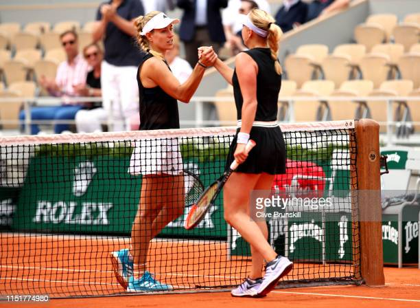 Angelique Kerber of Germany congratulates opponent Anastasia Potapova of Russia on victory following their ladies singles first round match during...
