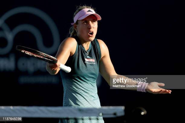 Angelique Kerber of Germany disputes a call while playing Karolina Muchova of Czech Republic during the Miami Open Presented by Itau at Hard Rock...
