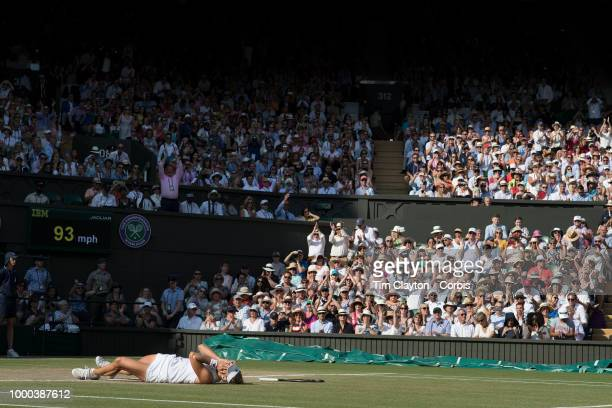 Angelique Kerber of Germany falls to the grass to celebrate her victory against Serena Williams of the United States in the Ladies' Singles Final on...
