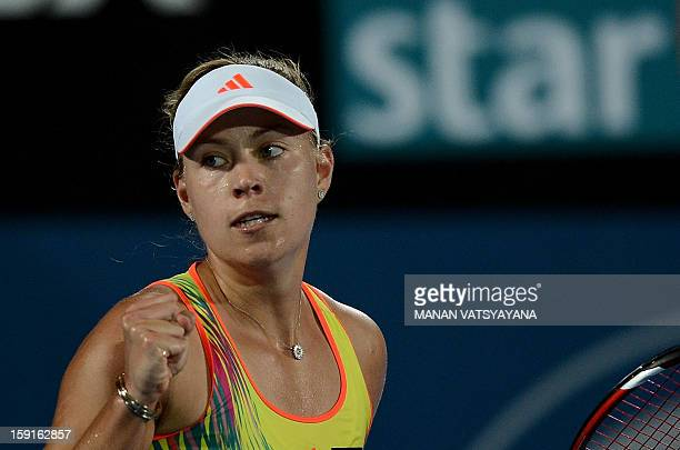 Angelique Kerber of Germany gestures after winning a set against Svetlana Kuznetsova of Russia during their quarter-final match of the Sydney...