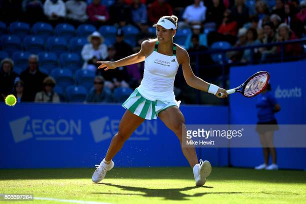 Angelique Kerber of Germany hits a forehand during the ladies singles quarter final match against Johanna konta of Great Britain on day five of the...