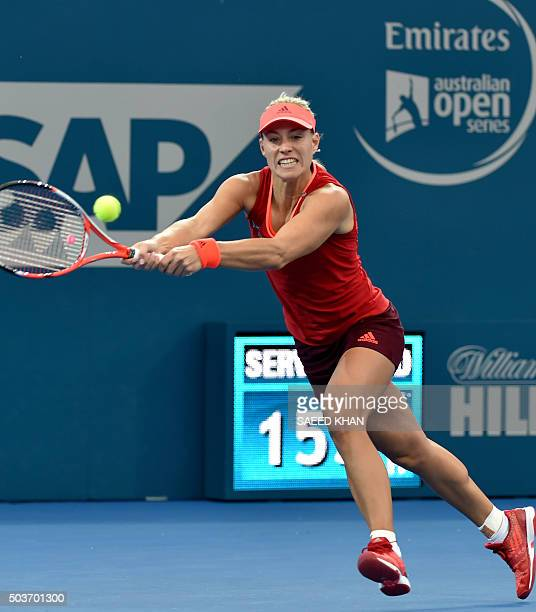 Angelique Kerber of Germany hits a return against Anastasia Pavlyuchenkova of Russia during their women's singles quarterfinal match on the fifth day...