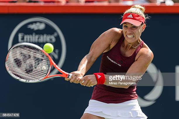 Angelique Kerber of Germany hits a return against Darya Kasatkina of Russia during day five of the Rogers Cup at Uniprix Stadium on July 29, 2016 in...