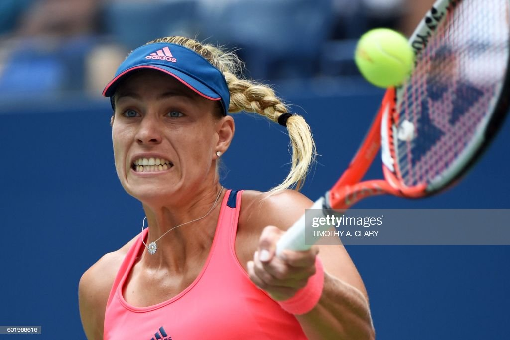 Angelique Kerber of Germany hits a return against Karolina Pliskova of the Czech Republic during their 2016 US Open Womens Singles final match at the USTA Billie Jean King National Tennis Center in New York on September 10, 2016. / AFP PHOTO / Timothy A. CLARY