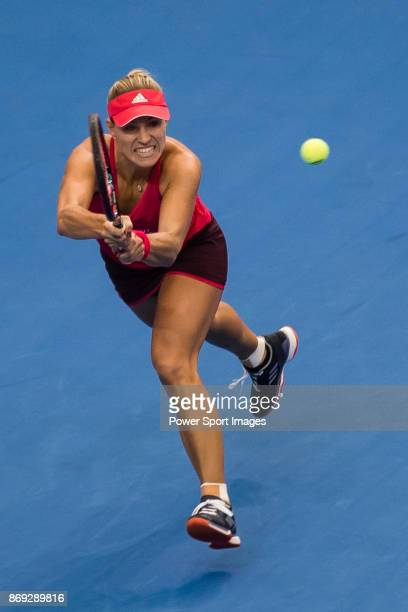 Angelique Kerber of Germany hits a return during the singles Round Robin match of the WTA Elite Trophy Zhuhai 2017 against Ashleigh Barty of...