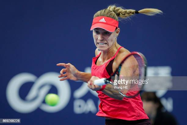 Angelique Kerber of Germany hits a return in her match against Ashlei Barty of Australia during the WTA Elite Trophy Zhuhai 2017 at Hengqin Tennis...