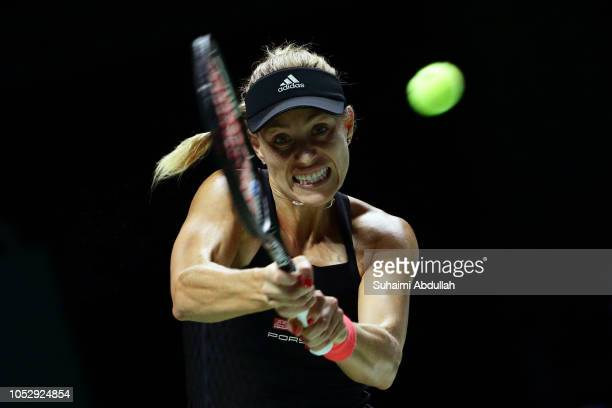 Angelique Kerber of Germany hits a return in her singles match against Naomi Osaka of Japan during day 4 of the BNP Paribas WTA Finals Singapore...
