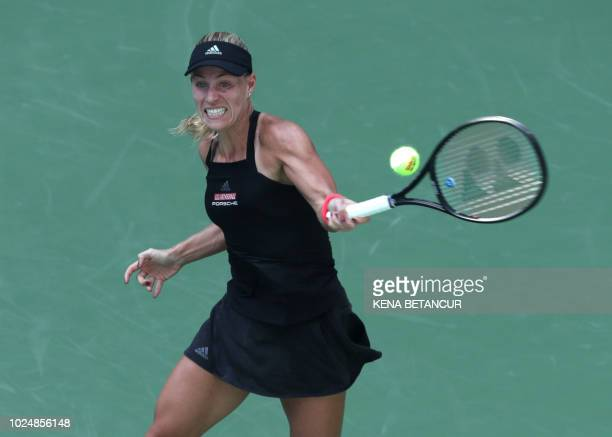 Angelique Kerber of Germany hits a return to Margarita Gasparyan of Russia during their 2018 US Open women's match August 28 2018 in New York