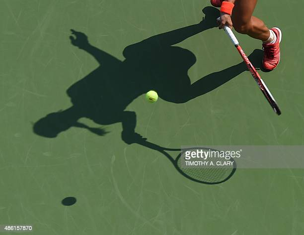 Angelique Kerber of Germany hits a shot against Alexandra Dulgheru of Romania during their 2015 US Open Women's singles round 1 match at the USTA...