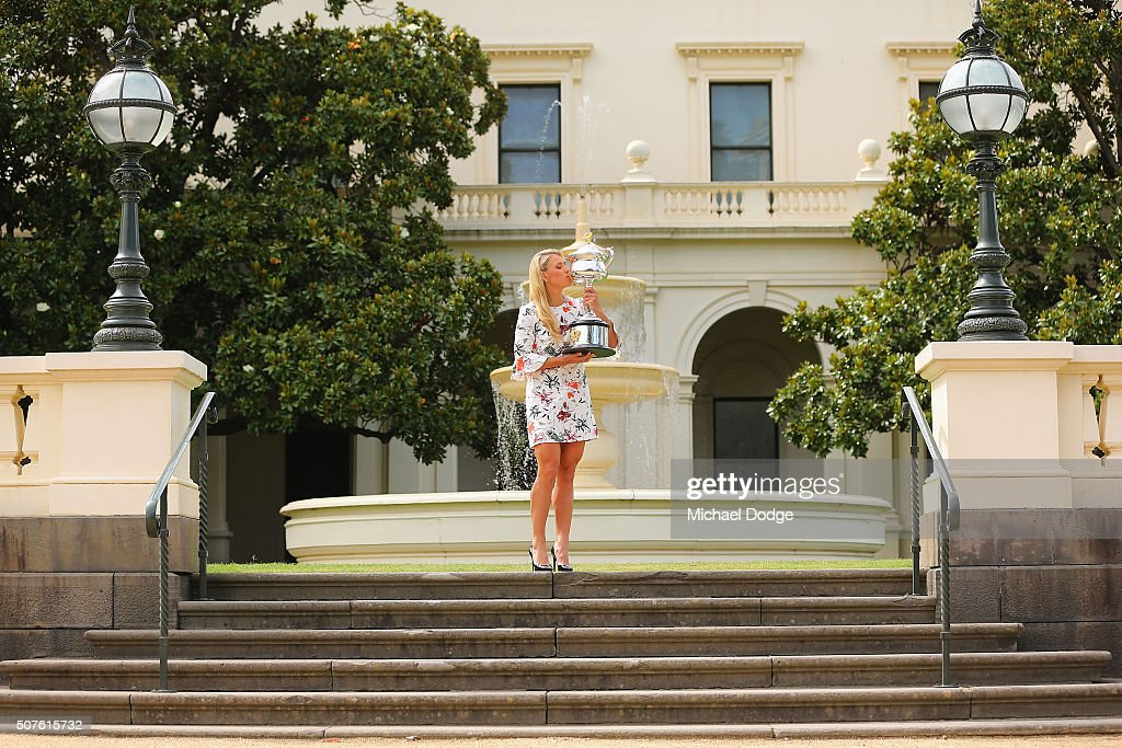Angelique Kerber of Germany holds the Daphne Akhurst Memorial Cup during a photocall at Government House after winning the 2016 Australian Open on January 31, 2016 in Melbourne, Australia.